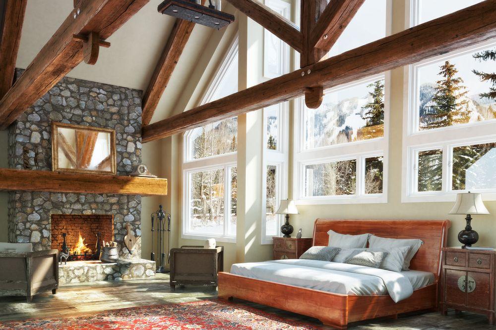 Dormitorios con pared de piedra natural